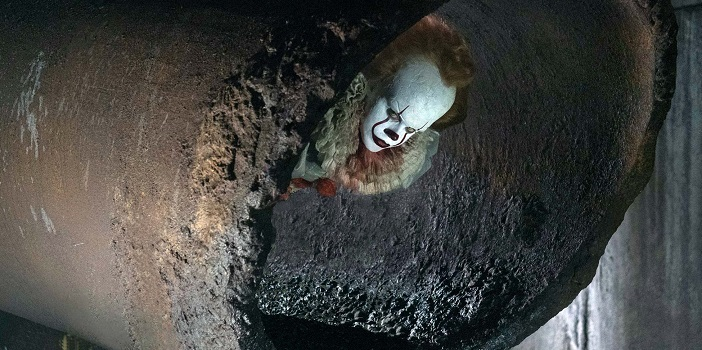 Behind-the-Scenes Photo From 'IT' Shows Pennywise in Action