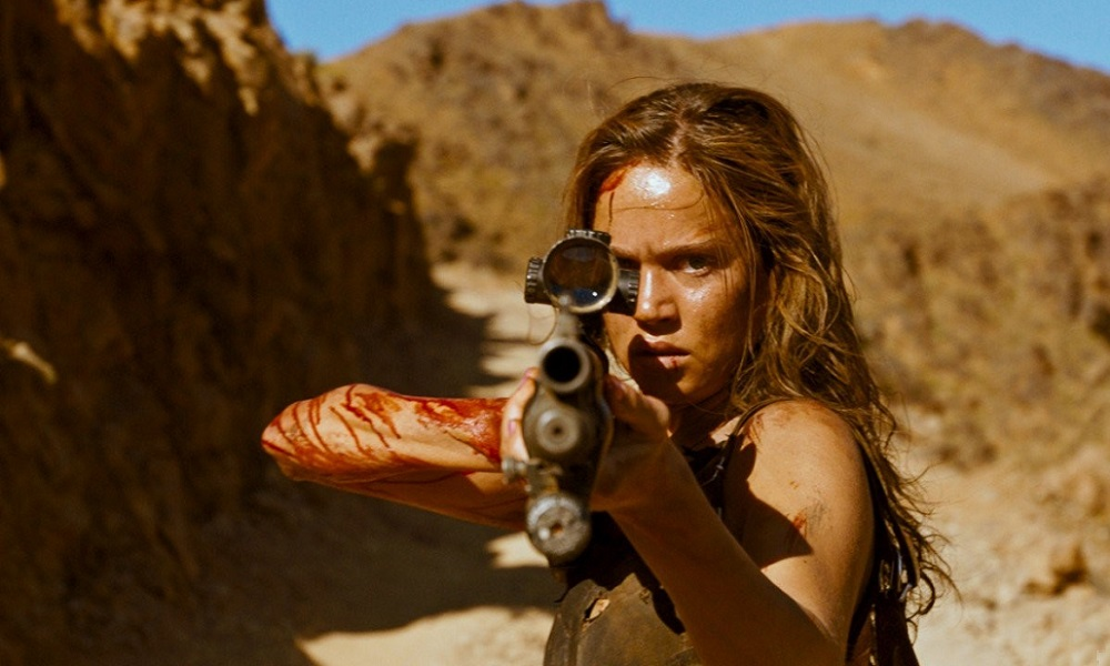 Matilda Lutz Hunt's Down Her Pray in New Bloody Clip from Coralie Fargeat's 'Revenge'