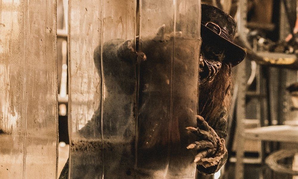 Linden Porco Stalks His Prey in New 'Leprechaun Returns' Photos