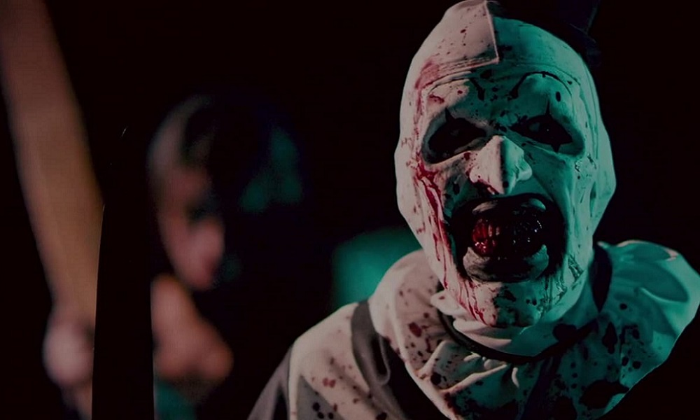 New Behind-the-Scenes Shot from the Set of 'Terrifier 2' Reveals a Bloody Art the Clown