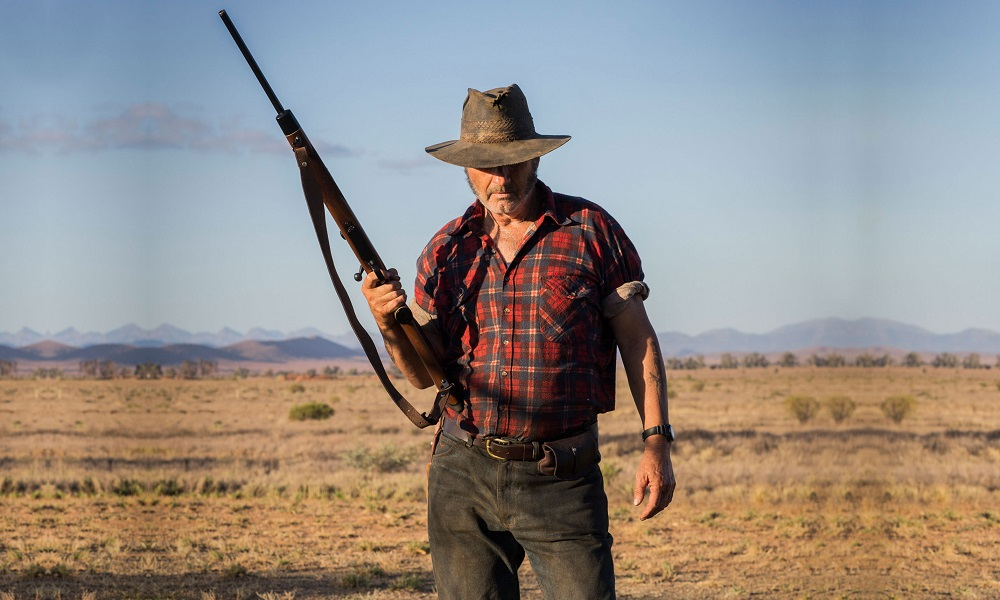 [Poster] John Jarratt is Back and Ready to Hunt in His Role as Mick Taylor in 'Wolf Creek 3'!
